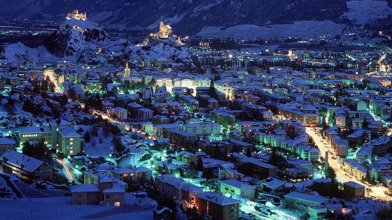 Les Jeux olympiques d'hiver de Sion 2026 risquent de coûter beaucoup plus que prévu. [Martin Ruetschi - Keystone]