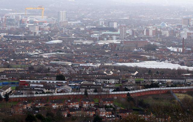 Photo d'un des murs de la paix à Belfast. [Paul Faith - AFP]