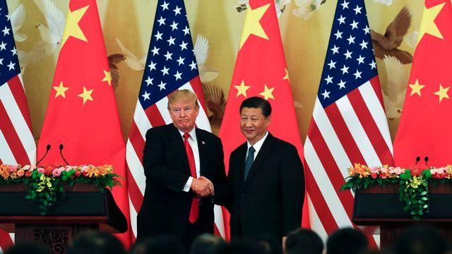 Le président américain Donald Trump avec son homologue chinois Xi Jinping, le 9 novembre à Pékin.  [Andy Wong - keystone]