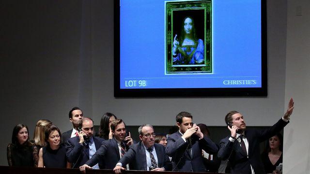 """""""Salvator Mundi"""" a trouvé acquéreur mercredi lors d'une vente aux enchères organisées par Christie's à New York. L'oeuvre signée de Vinci a battu tous les records. [PETER FOLEY - Keystone]"""