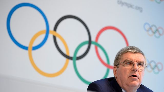Thomas Bach et les membres du CIO décideront mardi du sort de la Russie. [Fabrice Coffrini - AFP]