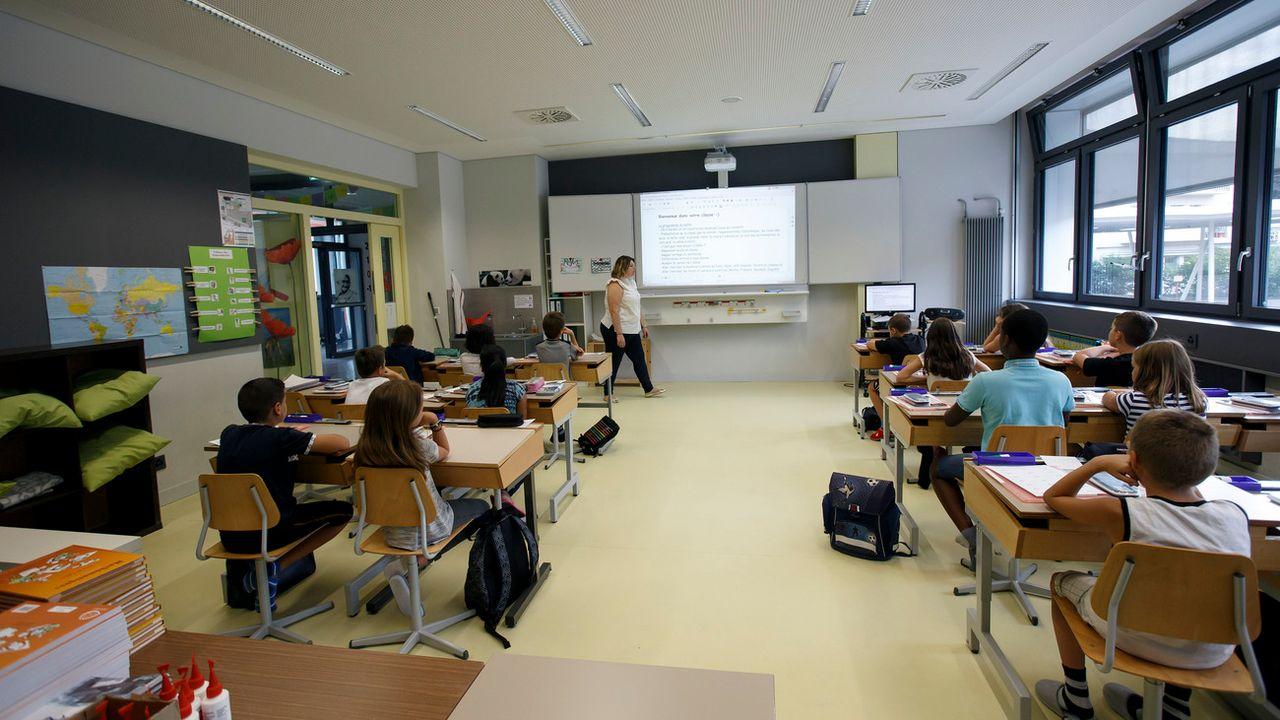 Une classe dans une école du Grand-Saconnex, à Genève. [Salvatore Di Nolfi - Keystone]