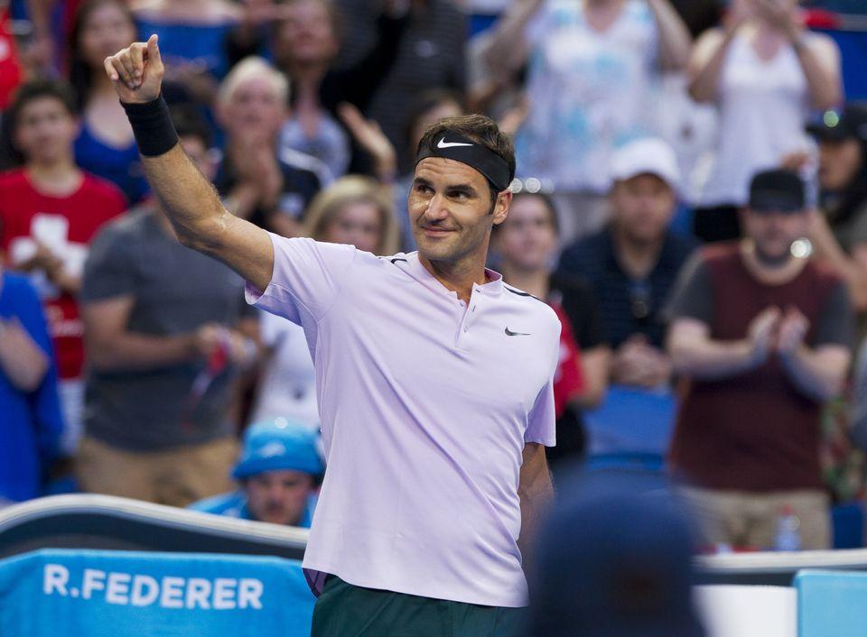 Federer remporte son deuxième simple de la compétition. [Tony Ashby - AFP]