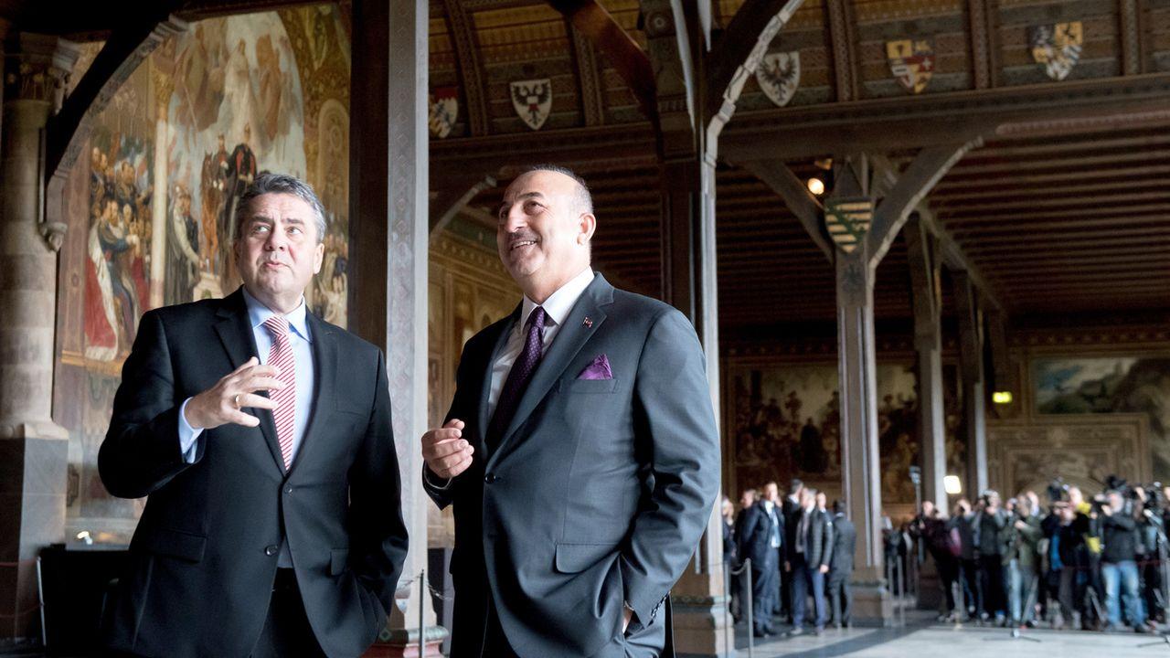 Les ministres des Affaires étrangères turc et allemand on affirmés leur volonté de reprendre le dialogue. [Swen Pförtner - Keystone]