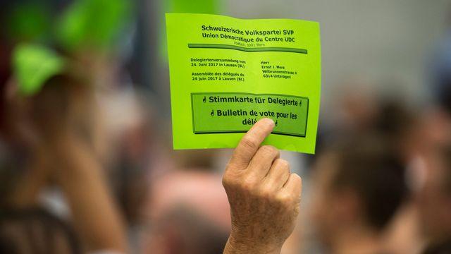 Les membres de l'UDC ont accepté le lancement d'une nouvelle initiative populaire contre l'immigration. [Georgios Kefalas - Keystone]