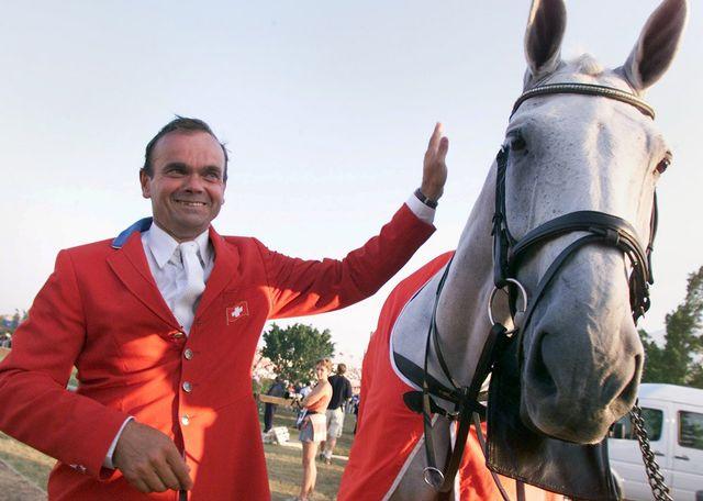 Melliger avec Calvaro aux Jeux olympiques de Sydney. [Fabrice Coffrini - Keystone]