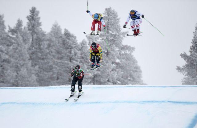 Marc Bischofberger (vert) a pris la troisième place au Canada, à Nakiska. [Pontus Lundahl - Keystone]