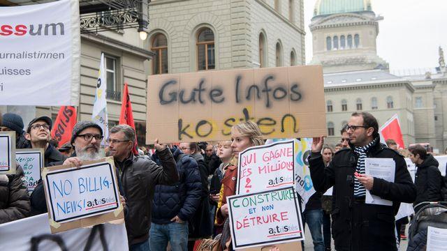 Les employés de l'Agence télégraphique suisse contestent le plan de restructuration mis en place par la direction.  [Anthony Anex - Keystone]