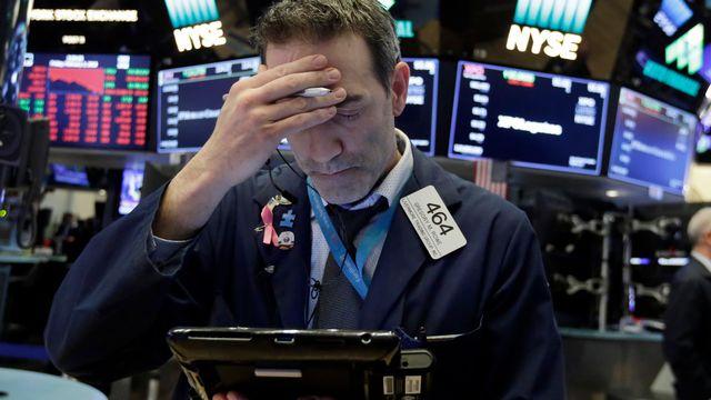 Un trader à la Bourse de New York lundi soir. [AP Photo/Richard Drew - Keystone]