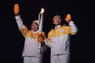 Les hockeyeuses Jong Su Hyon de Corée du nord et Park Jong-ah de Corée du Sud joueront ensemble pour ces jeux olympiques. [Aris Messinis - AFP]