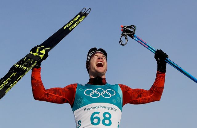 Dario Cologna laisse éclater sa joie après avoir remporté sa 4e médaille d'or olympique. [Kirsty Wigglesworth - Keystone]