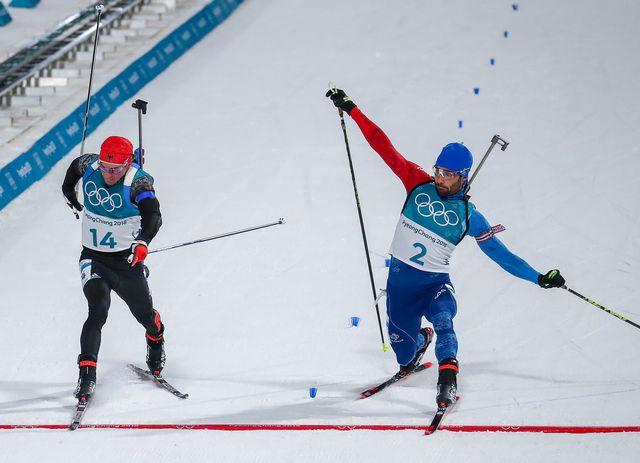 Grâce à cette victoire, Fourcade est devenu le Français le plus titré de l'histoire des JO d'hiver. [Daniel Karmann - AFP]