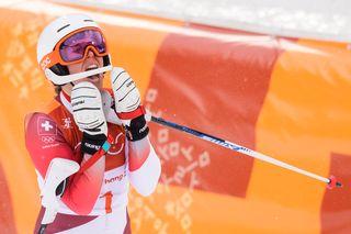 Quatre ans après sa soeur, Michelle Gisin donne une médaille d'or à la Suisse. [Jean-Christophe Bott - Keystone]