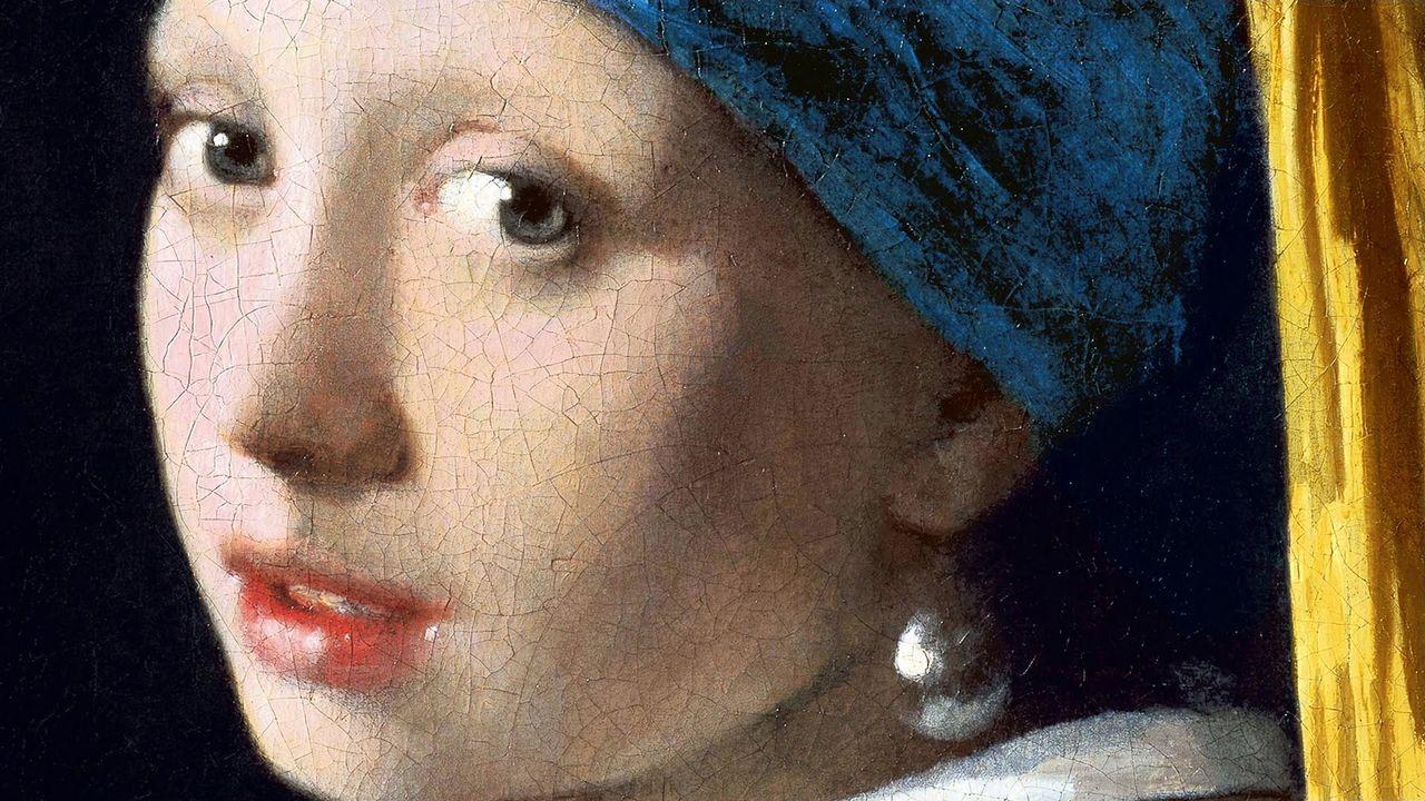 """Gros plan du tableau """"La Jeune fille à la perle"""" du peintre néerlandais Johannes Vermeer (v.1665)."""