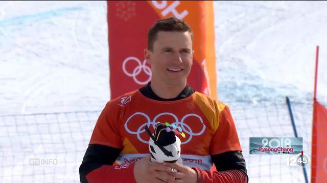JO - Snowboard: Nevin Galmarini remporte l'or dans le géant parallèle [RTS]