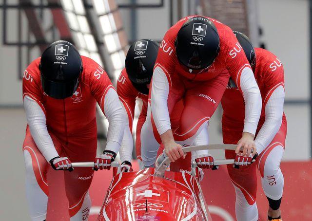 L'équipage du bob à quatre (Rico Peter, Michael Kuonen, Simon Friedli et Thomas Amrhein). [Wong Maye-E - AP Photo/Keystone]