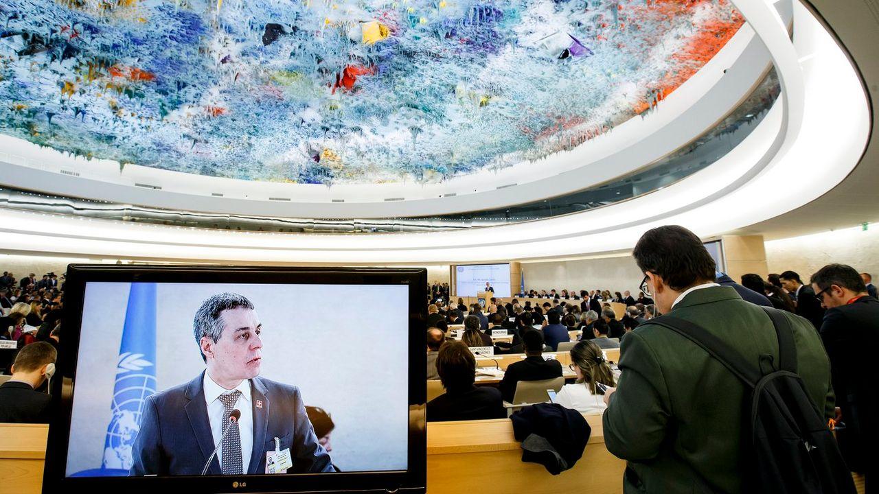 Iganzio Cassis, ministre des Affaires étrangères, à la tribune de la 37e session du Conseil des droits de l'homme, le 26 février 2018 à Genève. [Salvatore di Nolfi - Keystone]