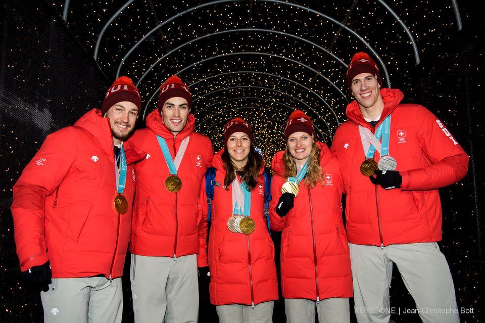 L'équipe du Team Event a décroché un magnifique titre pour la Suisse en ski alpin. [Jean-Christophe Bott - Keystone]