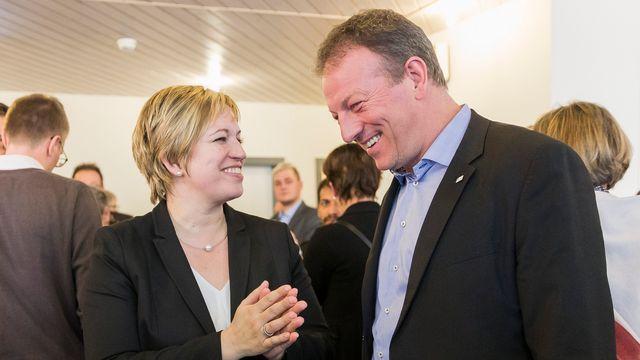 Valérie Piller Carrard et Didier Castella sont toujours en course pour le Conseil d'Etat fribourgeois. [Cyril Zingaro - Keystone]