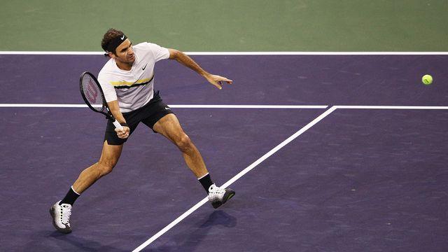 Roger Federer devra revenir sur le court dimanche pour terminer sa partie. [Adam Pretty - AFP]