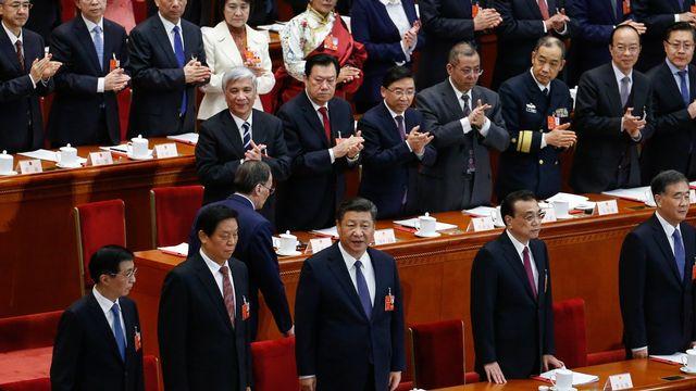 Le président Xi Jinping (au centre) lors de l'Assemblée nationale populaire. [EPA/ROMAN PILIPEY - Keystone]