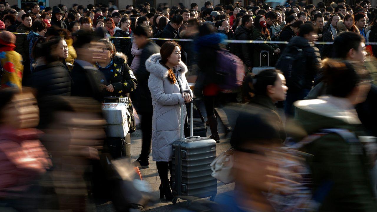Les autorités chinoises vont évaluer les citoyens en fonction de leur comportement. [Andy Wong - AP Photo / Keystone]
