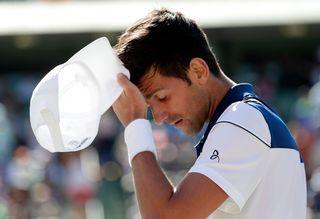 Djokovic n'y arrive toujours pas et se fait sortir au premier tour à Miami. 1 [Lynne Sladky - Keystone]