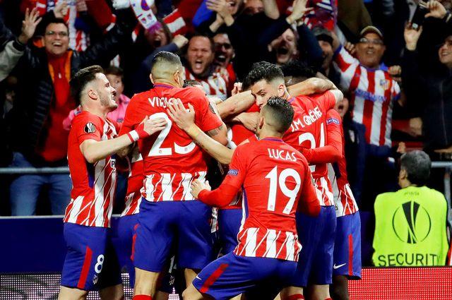 Les joueurs de l'Atlético jubilent après le but de Diego Costa. [Juanjo Martin - Keystone]