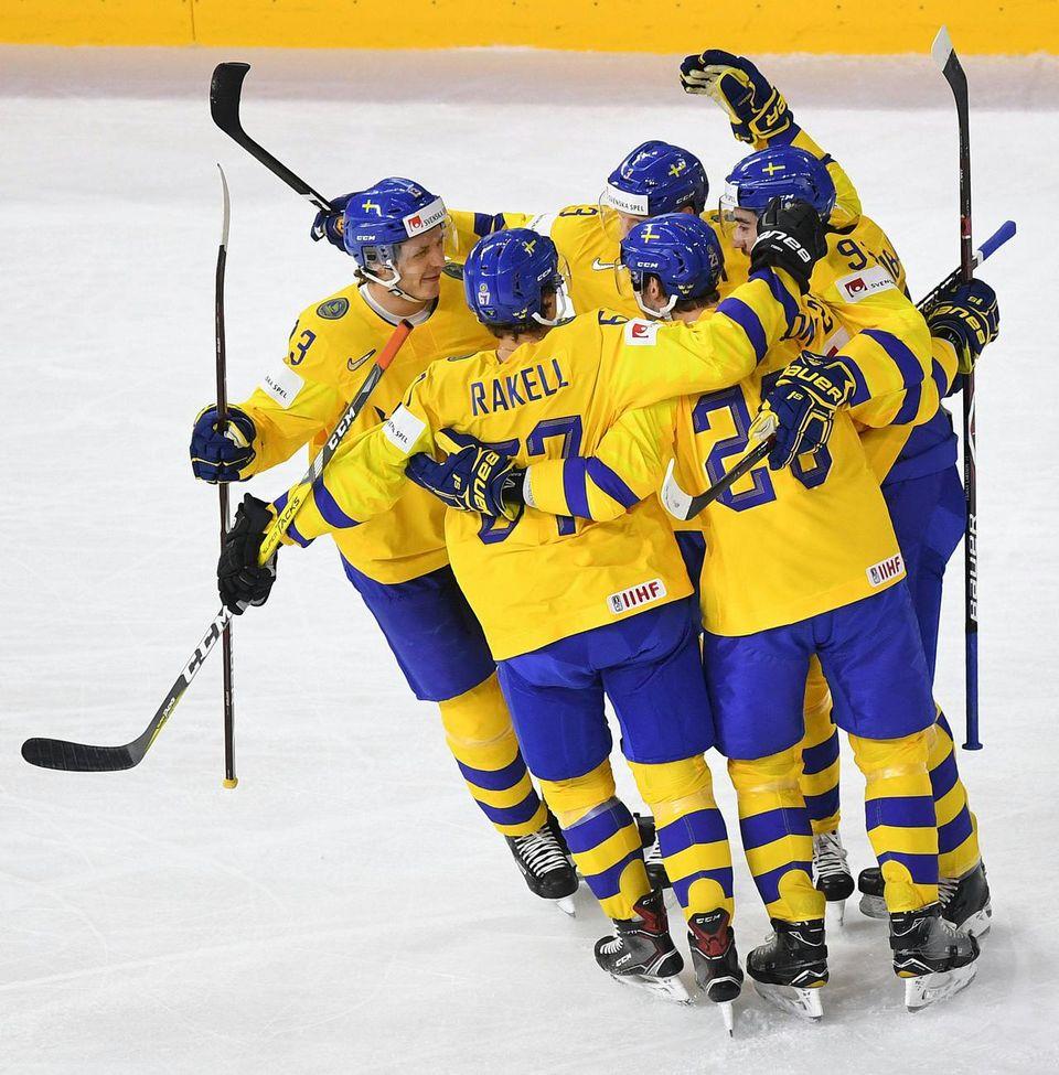 La Suède termine en tête du groupe A après sa victoire face à la Russie. [Helmut Fohringer - Keystone]