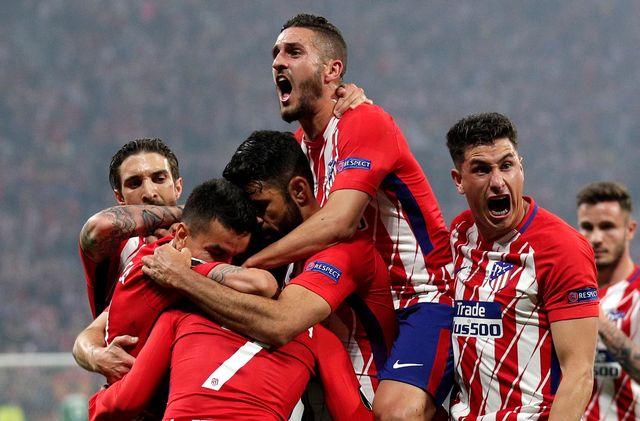 Les joueurs de l'Atlético Madrid célèbrent le but du 1-0. [Yoan Valat - Keystone]