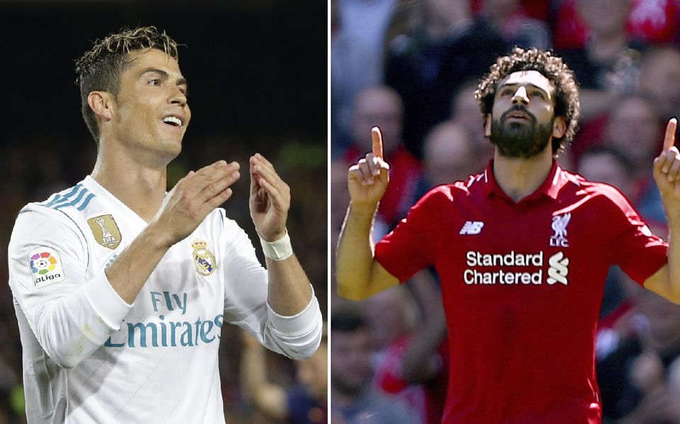 Cirstiano Ronaldo et Mohamed Salah croiseront le fer samedi à Kiev. [Emilio Morenatti/Dave Thompson - Keystone]