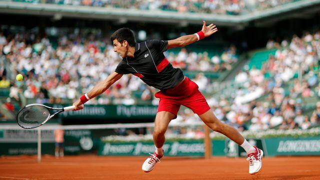 Djokovic a livré un match solide contre l'Espagnol. [Christophe Ena - Keystone]