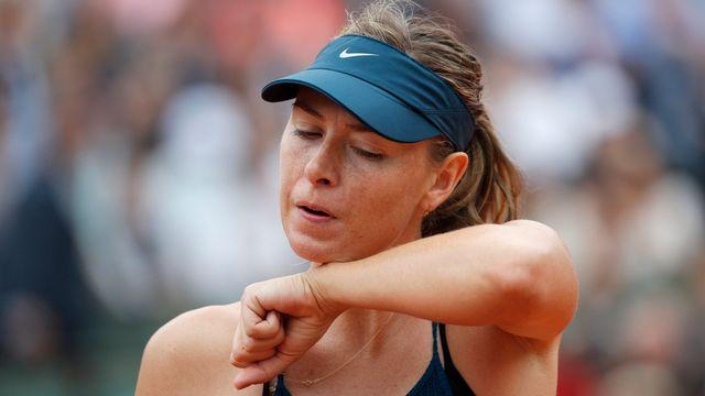 Sharapova n'a pas eu l'ombre d'une chance face à l'Espagnole. [Christophe Ena - Keystone]