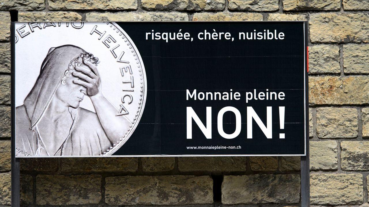 """Une affiche invitant à voter Non lors de la votation fédérale du 10 juin 2018 sur la """"Monnaie pleine"""". [Laurent Gillieron - Keystone]"""