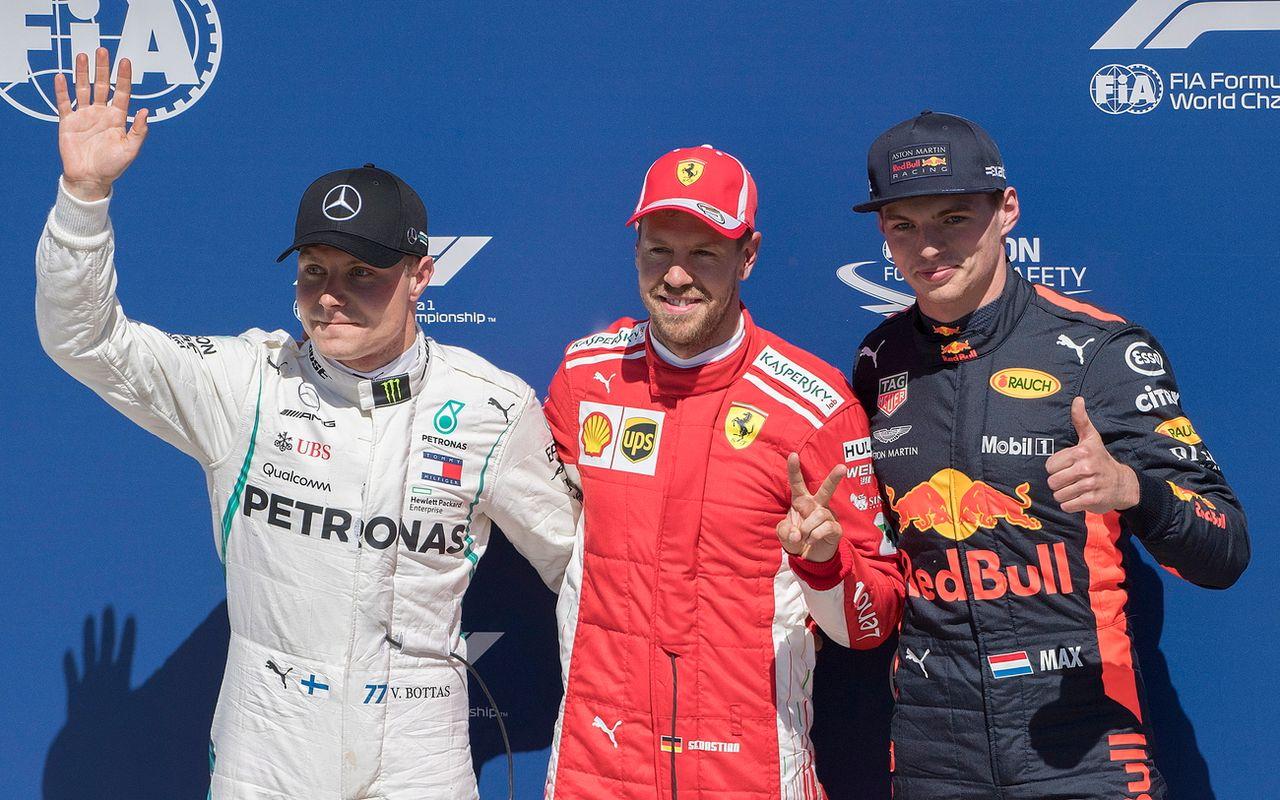 Le podium est composé de gauche à droite de Bottas, Vettel et Verstappen. [Graham Hughes - Keystone]