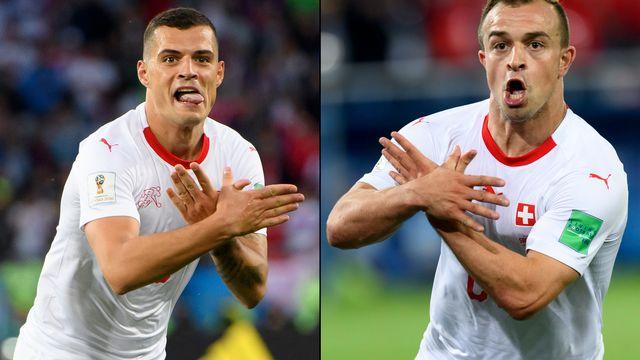 Les 2 joueurs suisses avaient mimé l'aigle albanais pour célébrer leur but. [Laurent Gillieron - Keystone]