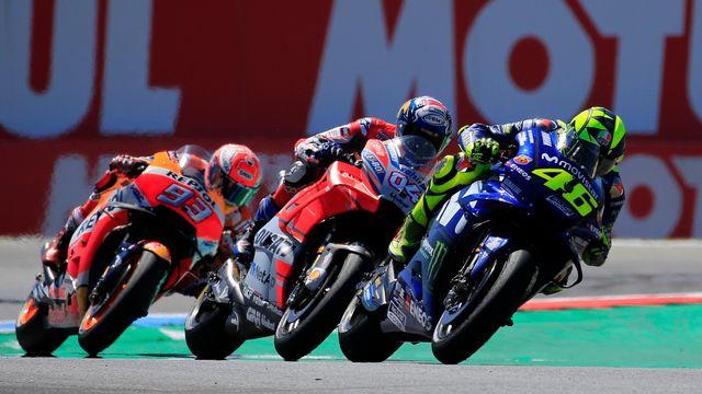 Marc Marquez (numéro 93), Dovizioso (numéro 4) et Valentino Rossi se sont livrés un beau duel aux Pays-Bas. [Peter Dejong - Keystone]