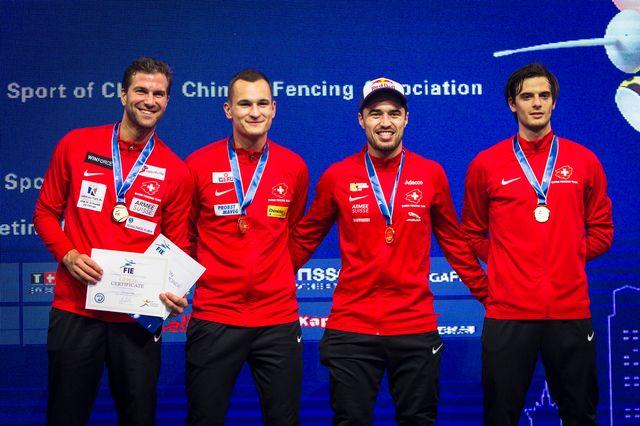 Max Heinzer et ses camarades ont conquis un premier titre mondial. [A.Plavevski - Keystone]
