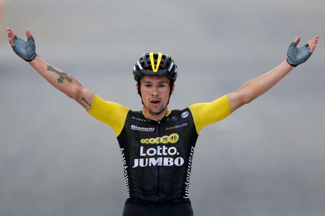 Primoz Roglic à l'arrivée de la 19e étape, en vainqueur. [Peter Dejong - Keystone]