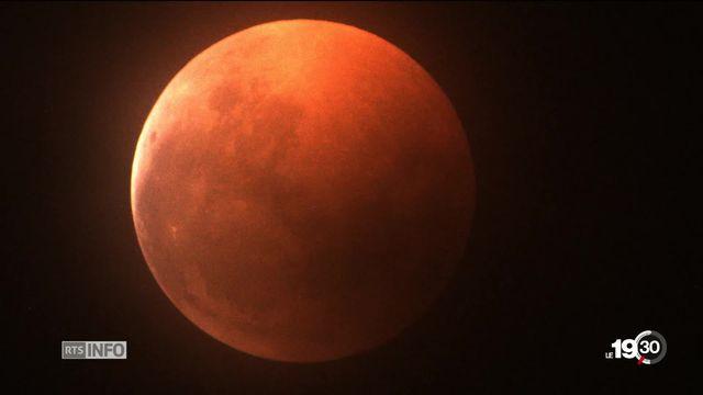 Spectacle planétaire de la plus longue éclipse lunaire totale de ce siècle. Obervation à la Société astronomique de Genève [RTS]