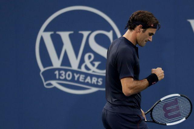 Federer est mené 23-22 dans ces duels avec Djokovic. [Rob Carr - AFP]