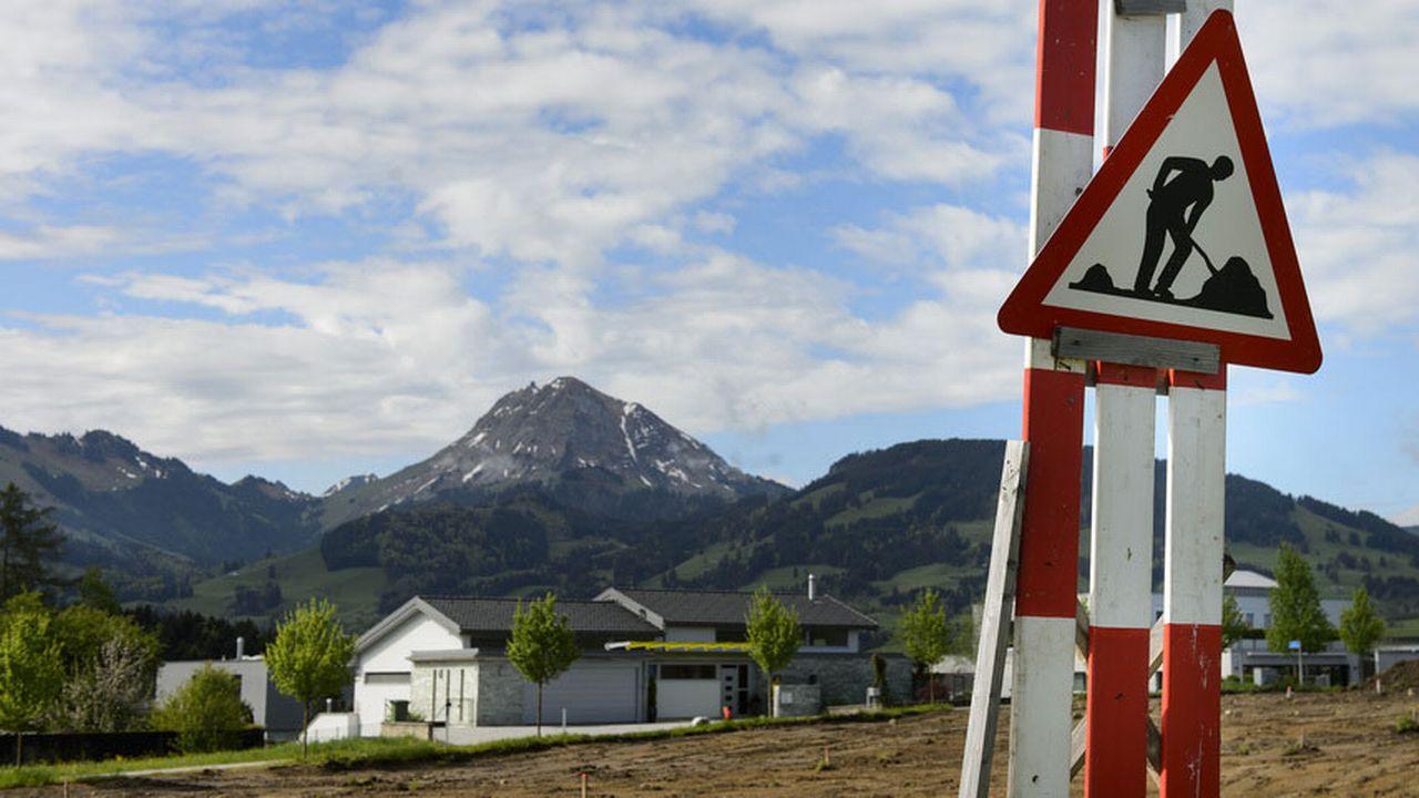 Où construire, quels types de logements et à quel prix? [Jean-Christophe Bott - Keystone]