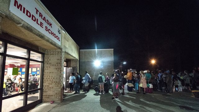 Des habitants de Wilmington, en Caroline du Nord, se réfugient dans une école avant l'arrivée de l'ouragan Florence. [Caitlin Penna - EPA/Keystone]