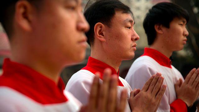 La Chine et le Vatican ont signé un accord historique. [Mark Schiefelbein - AP Photo/ Keystone]