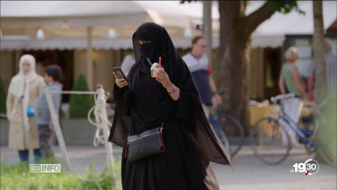 Après le Tessin, St-Gall vote l'interdiction de la burqa dans l'espace public [RTS]