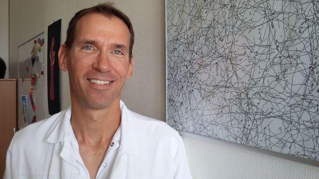 David Baud, chef de clinique du service d'obstétrique au CHUV. [Simon Corthay - RTS]
