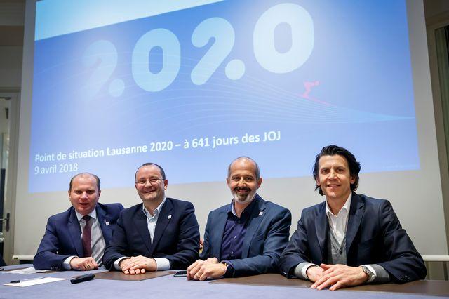 Philippe Leuba, conseiller d'Etat vaudois et vice-président du comite d'organisation de Lausanne 2020 et Patrick Baumann, président du comite d'organisation. [Valentin Flauraud - Keystone]
