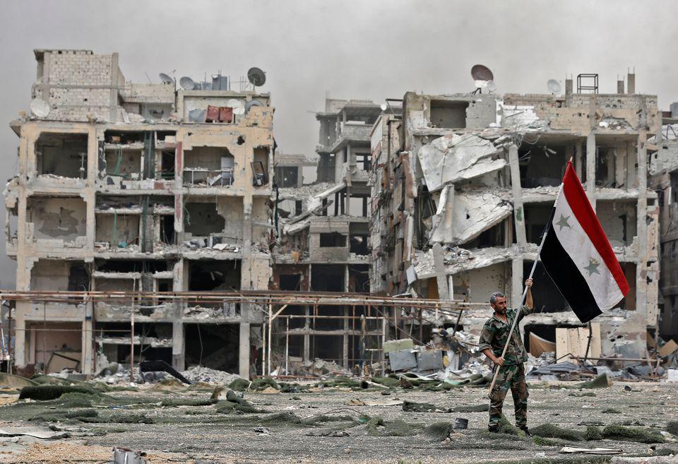 Plus de 350'000 personnes sont mortes en sept ans de guerre civile en Syrie. [Louai Beshara - AFP]