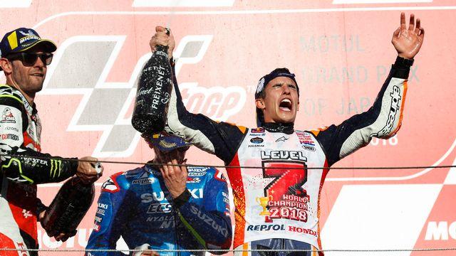 Marc Marquez fête son 5e titre en MotoGP lors de sa victoire au Japon. [Kimimasa Mayama - Keystone]