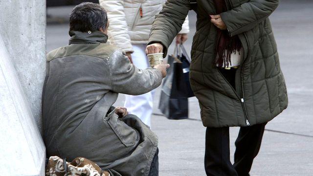 Un mendiant Rom dans les rues de Genève.  [Salvatore Di Nolfi - Keystone]